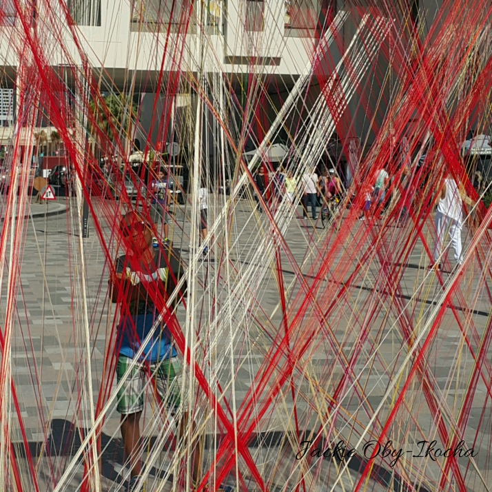 Caught in the mesh of street weaving.