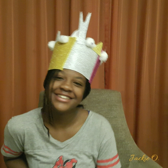Wearing a crown painstakingly made by my younger brother :)