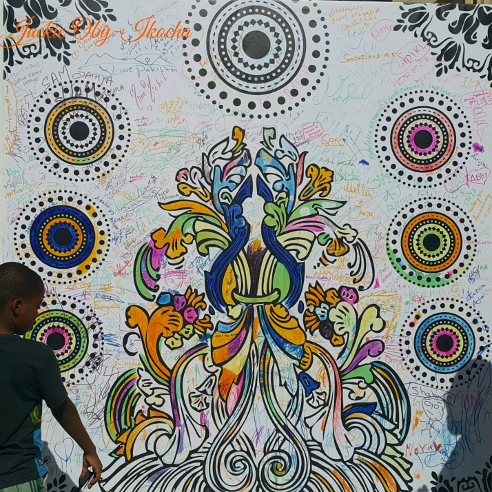 A big street art depicting harmony that had scribbles and signatures of thousands of people. We appended ours 😊