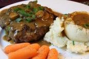 Some mashed potatoes, gravy, steak...