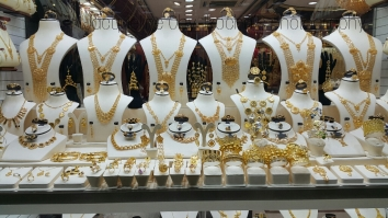 Admiring all the bling. YES it's all gold and other precious gems