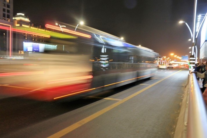 Fast moving bus, photograph